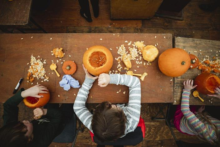 """<p>Pumpkin carving is a leisurely activity for most, but competitive carver Stephen Clarke set the Guinness World Record in 2013 by completing his masterpiece <a href=""""https://www.guinnessworldrecords.com/world-records/fastest-time-to-carve-one-pumpkin"""" rel=""""nofollow noopener"""" target=""""_blank"""" data-ylk=""""slk:in under 17 seconds"""" class=""""link rapid-noclick-resp"""">in under 17 seconds</a>. In order to qualify, the pumpkin had to have a nose, eyes, mouth, and ears.</p>"""