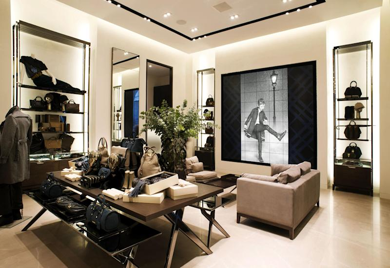 This undated publicity photo provided by BURBERRY shows an interior view of the new BURBERRY Flagship store opened in November 2012 on Michigan Avenue in Chicago. BURBERRY is interacting directly with consumers in the digital sphere too, launching projects like artofthetrench.com. The website invites users to upload pictures of themselves wearing BURBERRY trench coats. (AP Photo/BURBERRY)