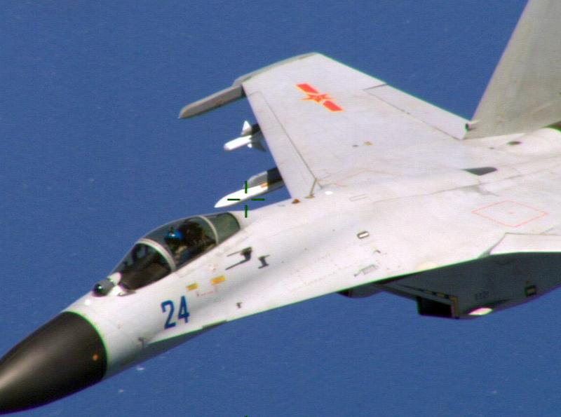 Image obtained on August 22, 2014 courtesy of the US Department of Defense shows a Chinese fighter jet in a photo taken by a US Navy P-8 crew
