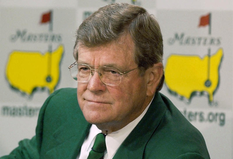 """FILE - This April 10, 2002 file photo shows Hootie Johnson, then chairman of the Augusta National Golf Club, listens to a question from a reporter during a news conference at the Augusta National Golf Club in Augusta, Ga. For the first time in its 80-year history, Augusta National Golf Club has female members. The home of the Masters, under increasing criticism the last decade because of its all-male membership, invited former Secretary of State Condoleezza Rice and South Carolina financier Darla Moore to become the first women in green jackets when the club opens for a new season in October. """"This is a joyous occasion,"""" Augusta National chairman Billy Payne said Monday, Aug. 20, 2012. The move likely ends a debate that intensified in 2002 when Martha Burk of the National Council of Women's Organizations urged the club to include women among its members. Former club chairman Hootie Johnson stood his ground, even at the cost of losing Masters television sponsors for two years, when he famously said Augusta National might one day have a woman in a green jacket, """"but not at the point of a bayonet."""" (AP Photo/Elise Amendola, File)"""