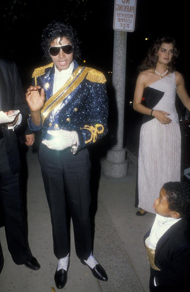 """Jackson dominated the 1984 Grammys, picking up 8 awards in one night: Seven for his album """"Thriller"""" and one for Best Recording for Children for the """"E.T. the Extra Terrestrial"""" album. The King of Pop hit the red carpet (with Brooke Shields and Emmanuel Lewis) in a look that still resonates with fans: One glove, jheri curl, sunglasses and a blue sequinned military jacket."""