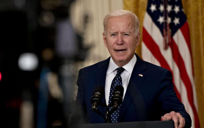 Joe Biden announced sanctions on Russia on Thursday for its election meddling and cyber attacks - BLOOMBERG