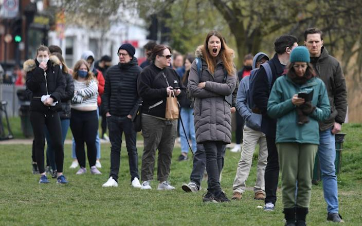 People queue to take a Covid-19 test at a mobile testing centre on Clapham Common. Residents in South London have been urged to get a test after 44 cases of the South Africa variant were detected in two boroughs - DANIEL LEAL-OLIVAS/AFP via Getty Images
