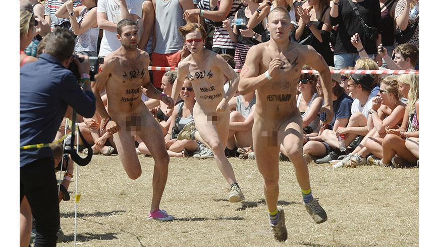Most people are there for the music, but 30 Danes stripped off for the annual Naked Run at Roskilde festival.