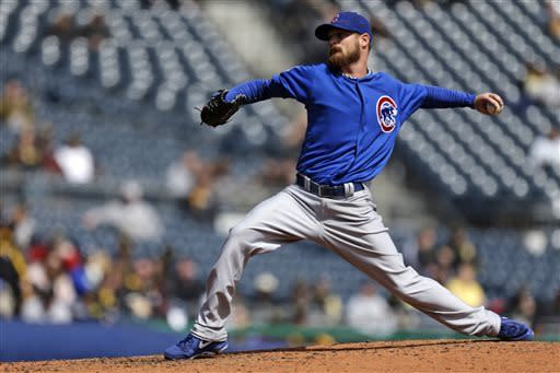 Chicago Cubs starting pitcher Travis Wood delivers in the fourth inning of a baseball game against the Pittsburgh Pirates in Pittsburgh, Thursday, April 4, 2013. (AP Photo/Gene J. Puskar)