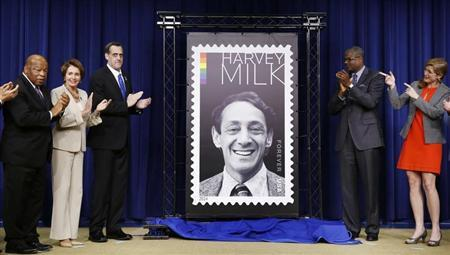 Representative John Lewis (Ga), House Minority Leader Nancy Pelosi, President of the Harvey Milk Foundation Stuart Milk, Deputy Postmaster General Ronald Stroman, and U.S. Ambassador to the UN Samantha Power (L to R) gesture as they unveil the Harvey Milk Forever Stamp at its dedication ceremony at the White House in Washington May 22, 2014. REUTERS/Larry Downing