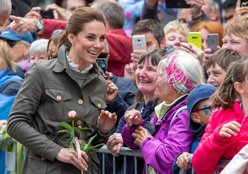 Britain's Catherine, Duchess of Cambridge greets well-wishers during a visit to the market town of Keswick, north west England on June 11, 2019, where she joined a celebration to recognise the contribution of individuals and local organisations in supporting communities and families across Cumbria. (Photo by Andy Commins / POOL / AFP) (Photo credit should read ANDY COMMINS/AFP/Getty Images)