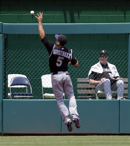 Colorado Rockies left fielder Carlos Gonzalez (5) jumps to bare-hand a ball off the wall hit by Washington Nationals Ryan Zimmerman during the first inning of a baseball game on Sunday, July 8, 2012 in Washington. (AP Photo/Alex Brandon)