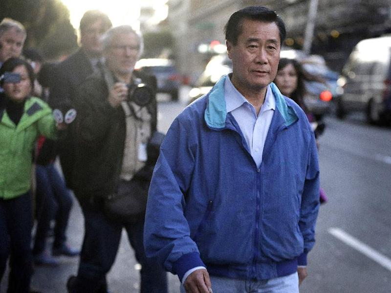 """FILE - In this Wednesday, March 26, 2014 file photo, California state Sen. Leland Yee, D-San Francisco, right, leaves the San Francisco Federal Building in San Francisco. So far in 2014, each month has brought news of another arrest or conviction of a Democratic California state senator. The latest was Wednesday's arrest of Yee, on federal corruption charges, news that roiled the capital and led one of Yee's opponents in the race for secretary of state to call the Legislature a """"corrupt institution."""" (AP Photo/Ben Margot,File)"""