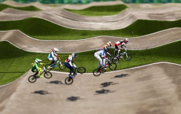 PHOTO: Cyclists go over a jump at the Women's BMX quarterfinal on day six of the Tokyo 2020 Olympic Games at Ariake Urban Sports Park on July 29, 2021 in Tokyo, Japan. (Ezra Shaw/Getty Images)