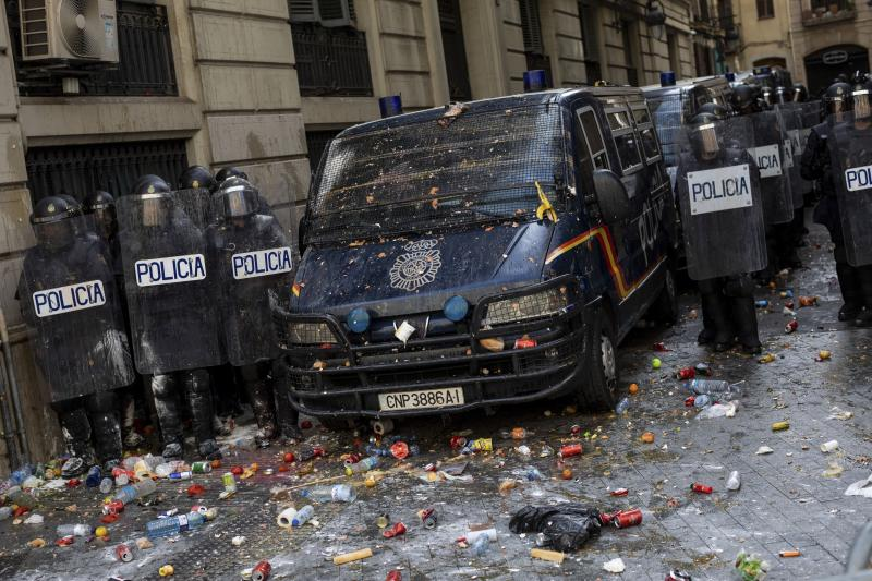 Spanish police stand outside a police station surrounded of objects thrown by pro-independence demonstrators in Barcelona, Spain, Friday, Oct. 18, 2019. (Photo: Bernat Armangue/AP)