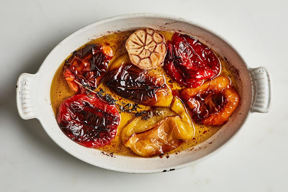 """Slow-roasting bell peppers allows them to become extra sweet and silky. Make them now and add them to meals throughout the week—they're great on ricotta toast or a grain bowl—or serve them as a hands-off side with sausages. <a href=""""https://www.epicurious.com/recipes/food/views/slow-cooked-bell-peppers-with-bay-leaves-and-oregano?mbid=synd_yahoo_rss"""" rel=""""nofollow noopener"""" target=""""_blank"""" data-ylk=""""slk:See recipe."""" class=""""link rapid-noclick-resp"""">See recipe.</a>"""