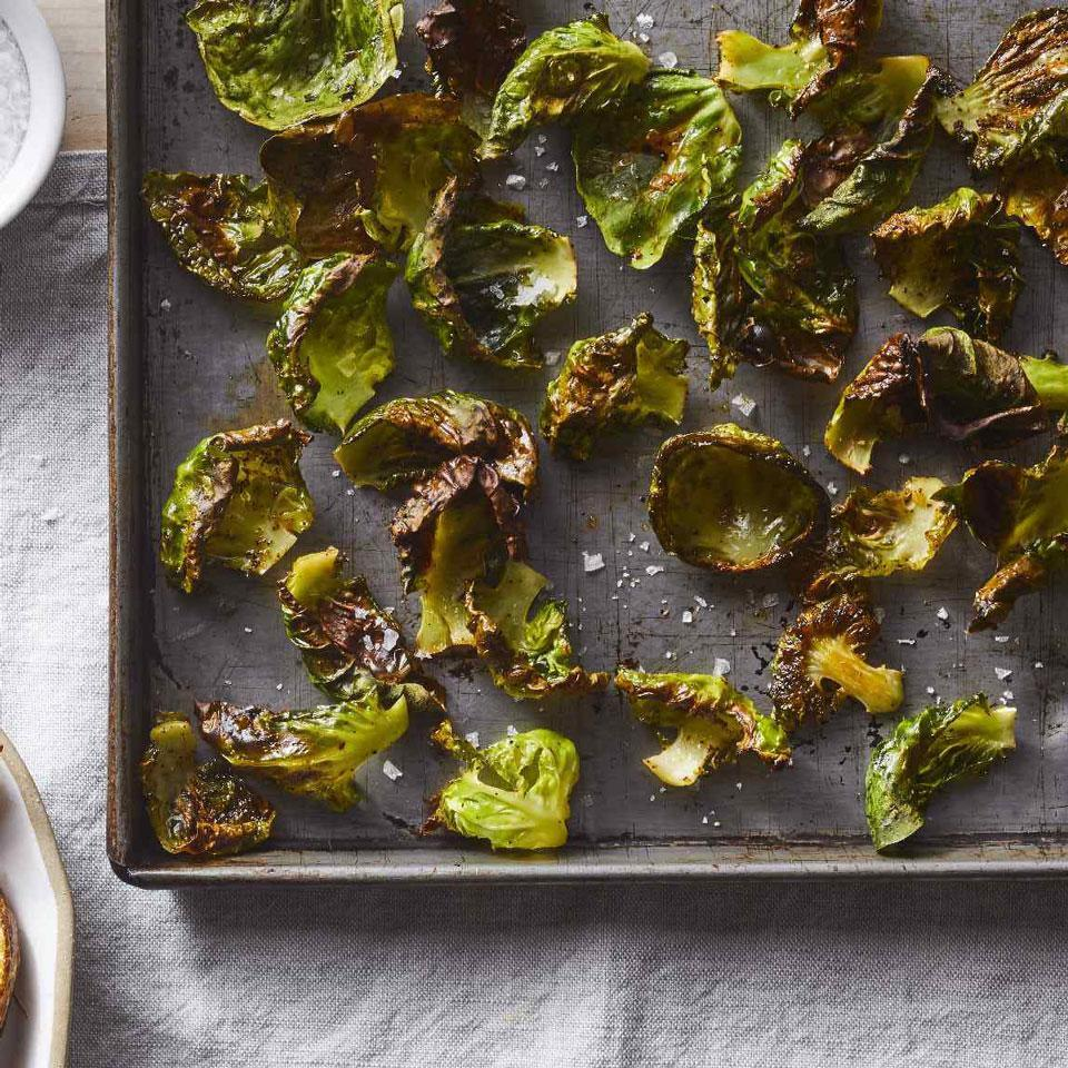 """<p>If you like kale chips, you'll love these veggie chips too! The outer leaves of large Brussels sprouts make the best """"chips."""" Plus, they're easier to remove than the tightly furled-together inner ones. Roast what's left over for dinner later in the week.</p>"""