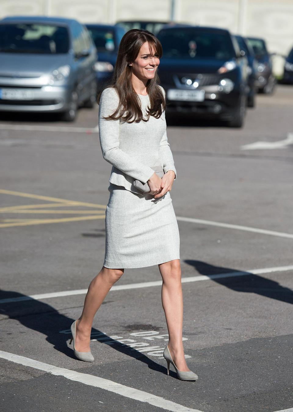 <p>On a visit to a women's prison, Kate wore a white tweed dress by Fold London and grey Jimmy Choo heels. She also carried a neutral-toned bag by Hobbs. </p><p><i>[Photo: PA]</i></p>