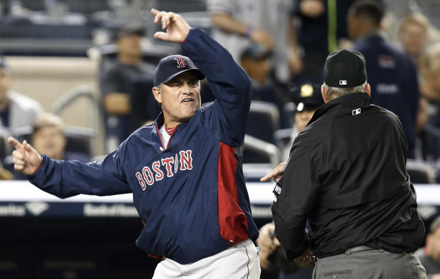 Boston Red Sox manager John Farrell gestures after was was ejected from the game by first base umpire Bob Davidson after Farrell objected to MLB's ruling of an overturned, fourth-inning, force out at first base in a baseball game against the New York Yankees at Yankee Stadium in New York, Sunday, April 13, 2014. The Yankees Brian McCann scored on the play. (AP Photo/Kathy Willens)