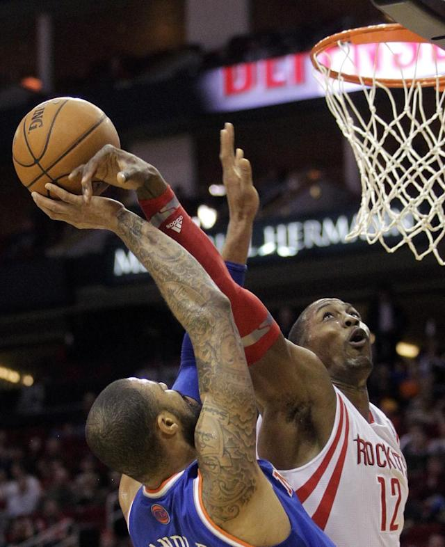 Houston Rockets center Dwight Howard (12) fouls New York Knicks center Tyson Chandler (6) during the second quarter of an NBA basketball game, Friday, Jan. 3, 2014, in Houston. (AP Photo/Patric Schneider)