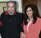 <p>Argentina's President Cristina Fernandez, right, and Cuba's former President Fidel Castro pose for a photo during a meeting in Havana, Wednesday, Jan. 21, 2009. (AP Photo/Argentinean Presidential Press Office) </p>