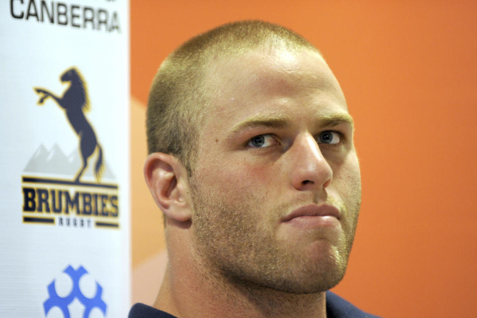 "Then ACT Brumbies vice captain Dan Palmer attends a press conference in Canberra on Feb. 15, 2012. Former Australia rugby union player Palmer has come out as gay in a lengthy self-written column in Fairfax Media published Friday, Oct. 30, 2020 in which he admits that it wasn't ""an exaggeration to say my own death felt preferable to anybody discovering I was gay."" Palmer made his only test appearance for Australia in 2012. (Alan Porritt/AAP Images via AP)"