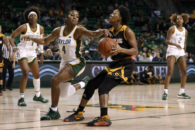 Baylor guard Te'a Cooper (4) moves to block a drive to the basket by Grambling State's Mylashia Yancey, right, in the first half of an NCAA college basketball game in Waco, Texas, Friday, Nov. 8, 2019. (AP Photo/Tony Gutierrez)