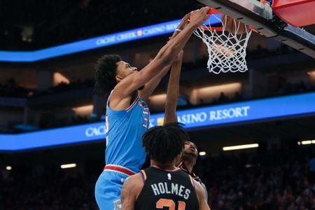 Feb 10, 2019; Sacramento, CA, USA; Sacramento Kings forward Marvin Bagley III (35) dunks the ball against Phoenix Suns forward Mikal Bridges (25) during the fourth quarter at Golden 1 Center. Mandatory Credit: Sergio Estrada-USA TODAY Sports