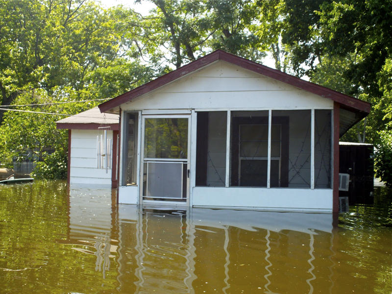 The flooded home of William Jefferson is shown Tuesday, May 10, 2011, in Vicksburg, Miss. Jefferson said the water started coming into his house a few days ago. Over the past week or so in the Delta, floodwaters along the rain-swollen river and its backed-up tributaries have already washed away crops, forced many people to flee to higher ground and closed some of the dockside casinos that are vital to the state's economy. But the worst is yet to come, with the crest expected to roll through the Delta over the next few days. (AP Photo/Robert Ray)