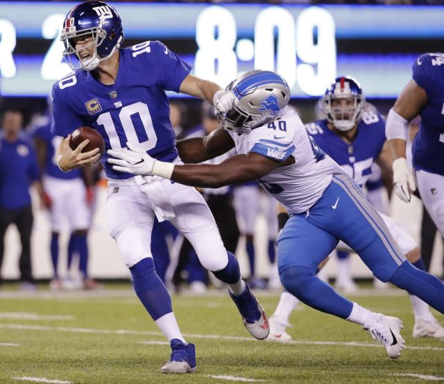New York Giants quarterback Eli Manning is sacked by the Detroit Lions' Jarrad Davis. (AP)