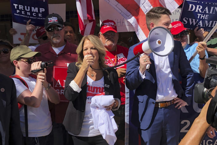Arizona Republican Party Chair Kelli Ward speaks to a crowd outside a field office for a Democratic congressman in Casa Grande, Ariz., in October 2019. (AP Photo/Jonathan J. Cooper)