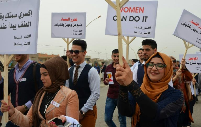 Iraqis take part in a Women's Day march in the city of Mosul on March 8, 2018 eight months after Iraqi forces retook the northern Iraqi city from Islamic State (IS) jihadists