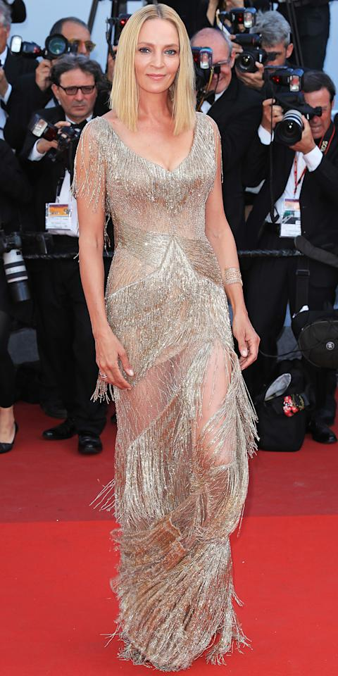 <p>Uma was at it again at the closing ceremonies in a stunning, gold-fringed Atelier Versace gown, a high-drama look which she finished off with a metallic sandal. </p>