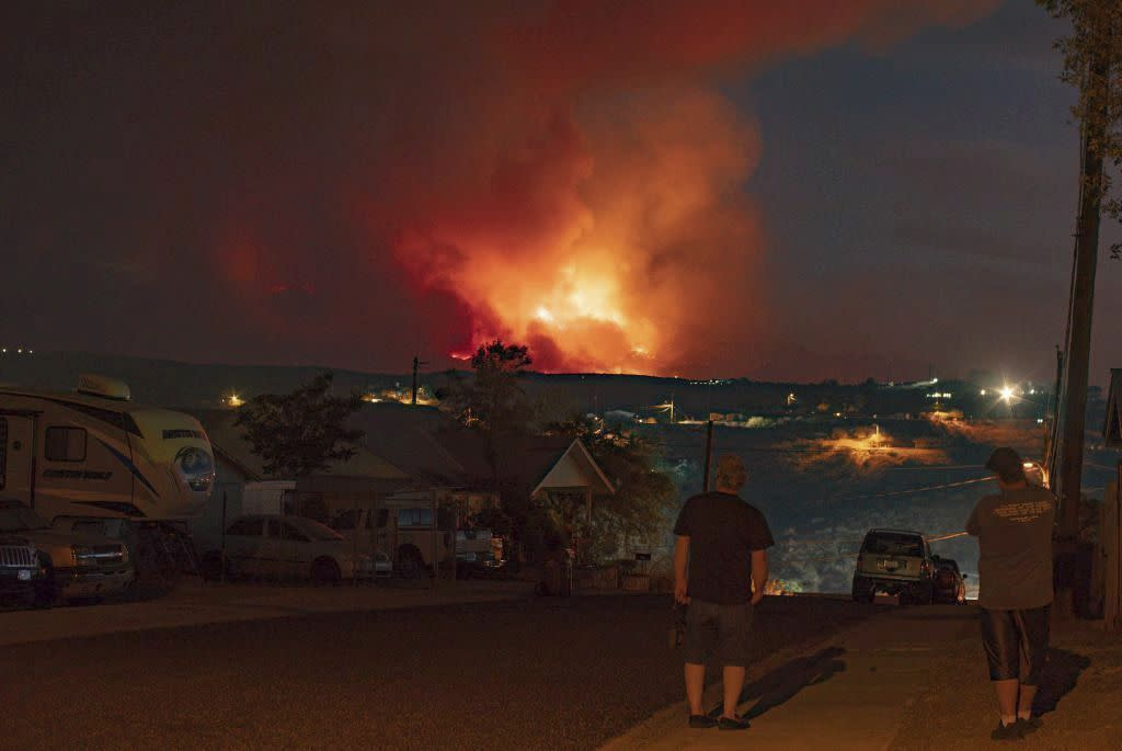 In this photo provided by Joseph Pacheco, a wildfire is seen burning in Globe, Ariz., on Monday.