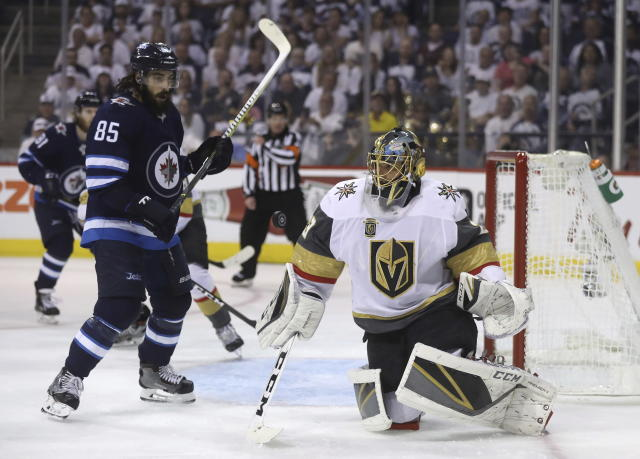 Winnipeg Jets' Mathieu Perreault (85) stands in front of Vegas Golden Knights goaltender Marc-Andre Fleury (29) during second period NHL Western Conference Finals game 5 hockey in Winnipeg, Sunday, May 20, 2018. (Trevor Hagan/The Canadian Press via AP)
