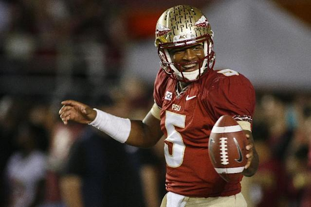 FILE - In this Nov. 2, 2013 file photo, Florida State quarterback Jameis Winston (5) smiles before the start of an NCAA college football game against Miami, in Tallahassee, Fla. Winston envisioned winning the Heisman Trophy before signing with the top-ranked Seminoles. He is one of six finalists for the award and will find out Saturday if his dream comes true. (AP Photo/Phil Sears, File)