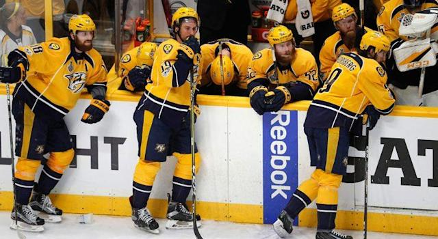"<a class=""link rapid-noclick-resp"" href=""/nhl/teams/nas/"" data-ylk=""slk:Nashville Predators"">Nashville Predators</a>' players react after their 2-0 loss to the <a class=""link rapid-noclick-resp"" href=""/nhl/teams/pit/"" data-ylk=""slk:Pittsburgh Penguins"">Pittsburgh Penguins</a> in Game 6. (Jeff Roberson/AP)"
