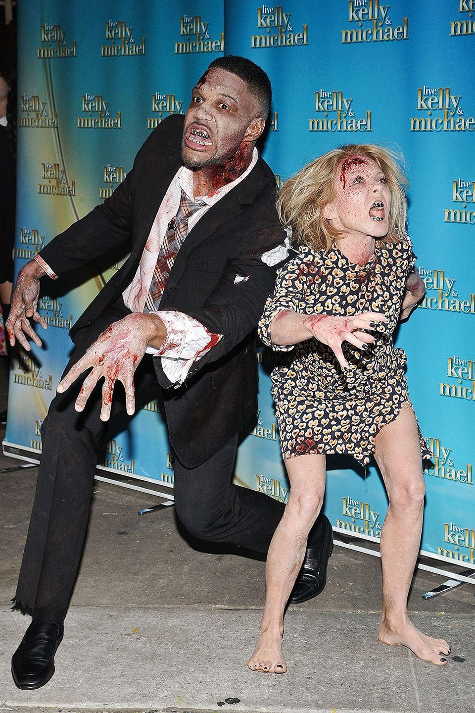 <p>Michael Strahan and Kelly Ripa rocked their best zombie looks in 2014 for the <em>Live With Kelly & Michael</em> Halloween show. Dance moves not necessary.</p>