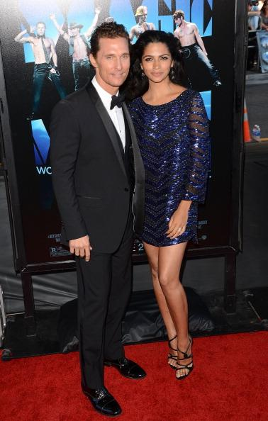 """<div class=""""caption-credit""""> Photo by: Getty Images</div><div class=""""caption-title"""">Matthew McConaughey and Camila Alves</div>The actor and his Brazilian wife were also chosen as part of Huffington Post's <i>2012 Best Dressed Newylyweds</i> , taking the sixth position. Alves, in a blue sequined Marchesa mini dress, and McConaughey in classic Dolce & Gabbana tuxedo, looked impressive at the """"Magic Mike"""" premiere."""