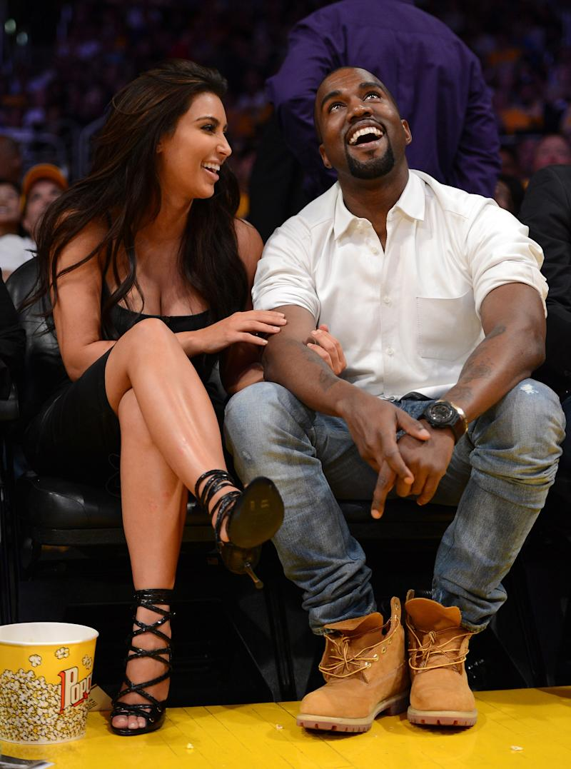 While Kanye West looked casual in a white button-down, jeans, and boots, Kim Kardashian was all glammed up in strappy sandals and a little black dress to watch the Los Angeles Lakers take on the Denver Nuggets in Game Seven of the Western Conference Quarterfinals in the 2012 NBA Playoffs.