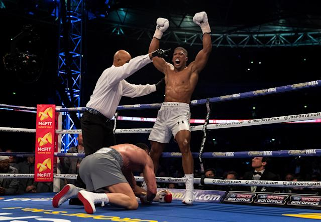 Anthony Joshua celebrates his 11th-round TKO of Wladimir Klitschko in what was a leading contender for the 2017 Yahoo Sports boxing Fight of the Year. (Getty Images)