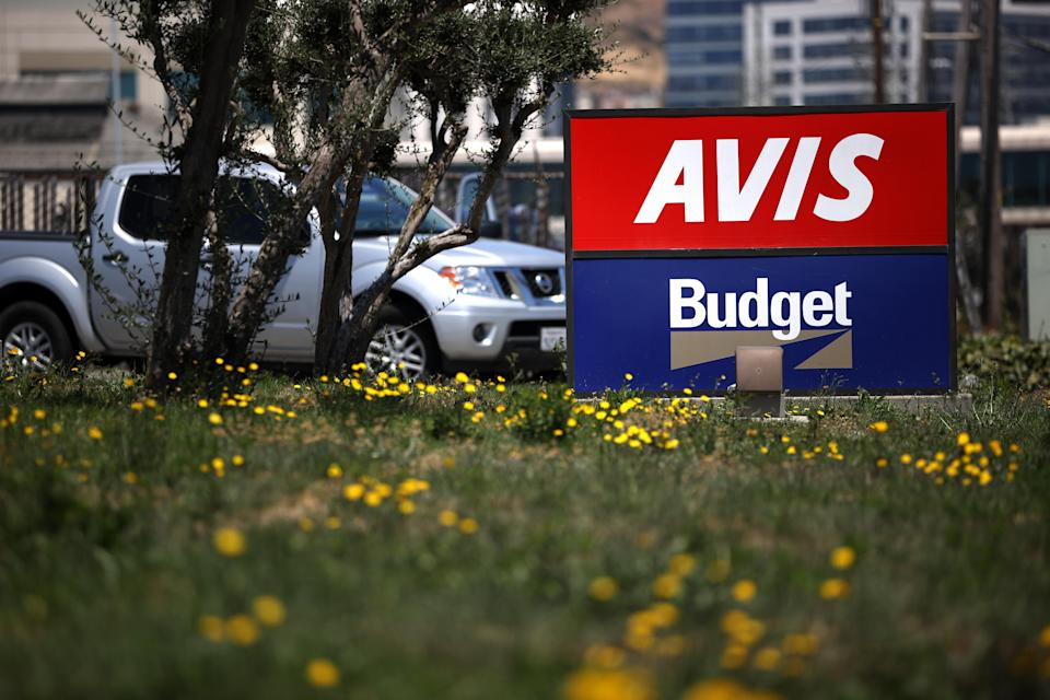 SOUTH SAN FRANCISCO, CALIFORNIA - JULY 28: A sign is posted in front of an Avis Budget rental car office on July 28, 2020 in South San Francisco, California. Avis Budget Group reported second quarter earnings with an adjusted net loss of $388 million and a 67 percent decline in revenues compared to one year ago. (Photo by Justin Sullivan/Getty Images)