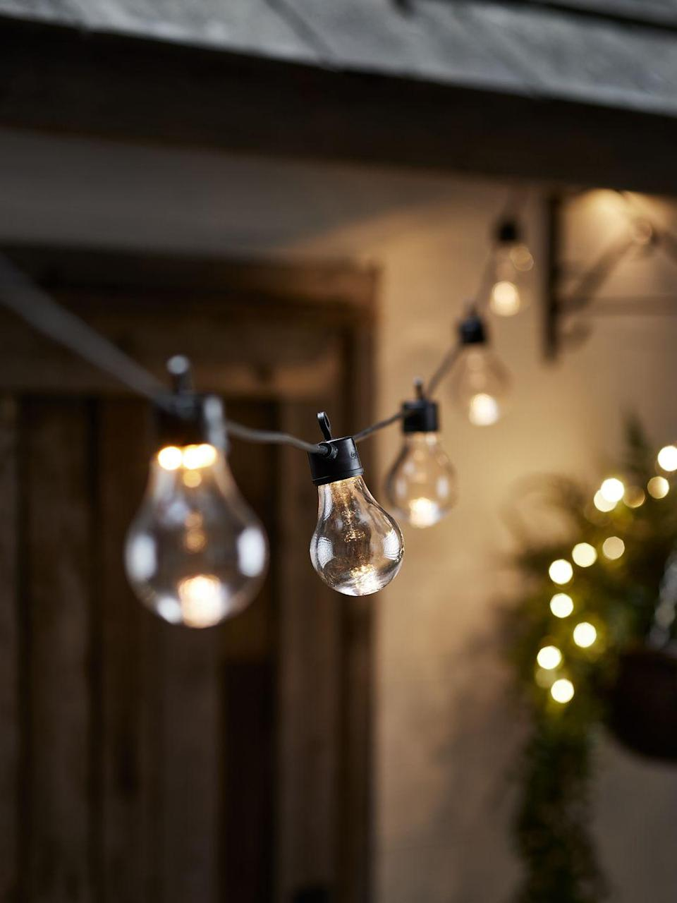 """<p>Create an ambient glow in your <a href=""""https://www.housebeautiful.com/uk/garden/a36163508/garden-lighting-ideas/"""" rel=""""nofollow noopener"""" target=""""_blank"""" data-ylk=""""slk:garden"""" class=""""link rapid-noclick-resp"""">garden</a> this summer by hanging a string of festoon lights. Perfect for letting your outdoor space take shape, they can either be strung along a fence, secured with a festoon light pole or hung from one end of the garden to the other. Warm, summer days we're ready for you!</p><p>Pictured: Warm festoon lights, £29.99, Lights4Fun</p><p><a class=""""link rapid-noclick-resp"""" href=""""https://www.housebeautiful.com/uk/garden/a36163508/garden-lighting-ideas/"""" rel=""""nofollow noopener"""" target=""""_blank"""" data-ylk=""""slk:READ MORE: GARDEN LIGHTING IDEAS"""">READ MORE: GARDEN LIGHTING IDEAS</a></p>"""