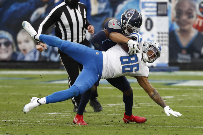 Detroit Lions tight end Hunter Bryant (86) is tackled by Tennessee Titans cornerback Malcolm Butler during the first half of an NFL football game Sunday, Dec. 20, 2020, in Nashville, N.C. (AP Photo/Wade Payne)