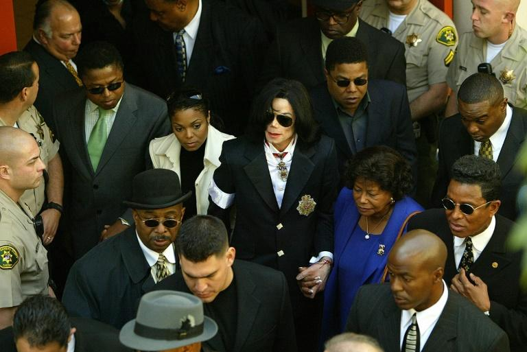 "The show follows a new raft of allegations that Jackson groomed and sexually assaulted children, detailed in the 2018 documentary ""Finding Neverland"". The star, shown here at his arraignment for child molestation charges in 2004, was acquitted"