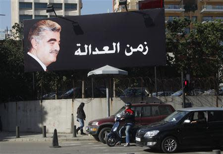 A billboard of former Prime Minister Rafik al-Hariri is displayed along a street in Beirut