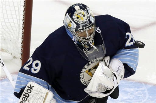 Pittsburgh Penguins goalie Marc-Andre Fleury blocks a shot in first period of an NHL hockey game against the Florida Panthers in Pittsburgh on Friday, Feb. 22, 2013. (AP Photo/Gene J. Puskar)