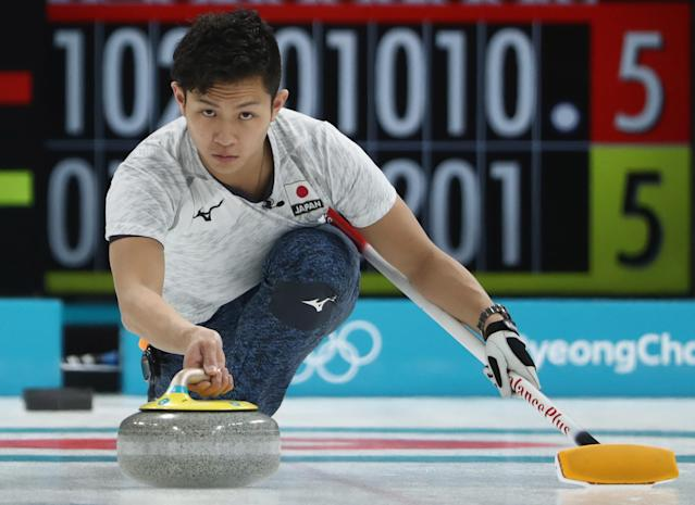 <p>Kosuke Morozumi of Japan delivers a stone during the Curling Men's Round Robin Session 3 held at Gangneung Curling Centre on February 15, 2018 in Gangneung, South Korea. </p>