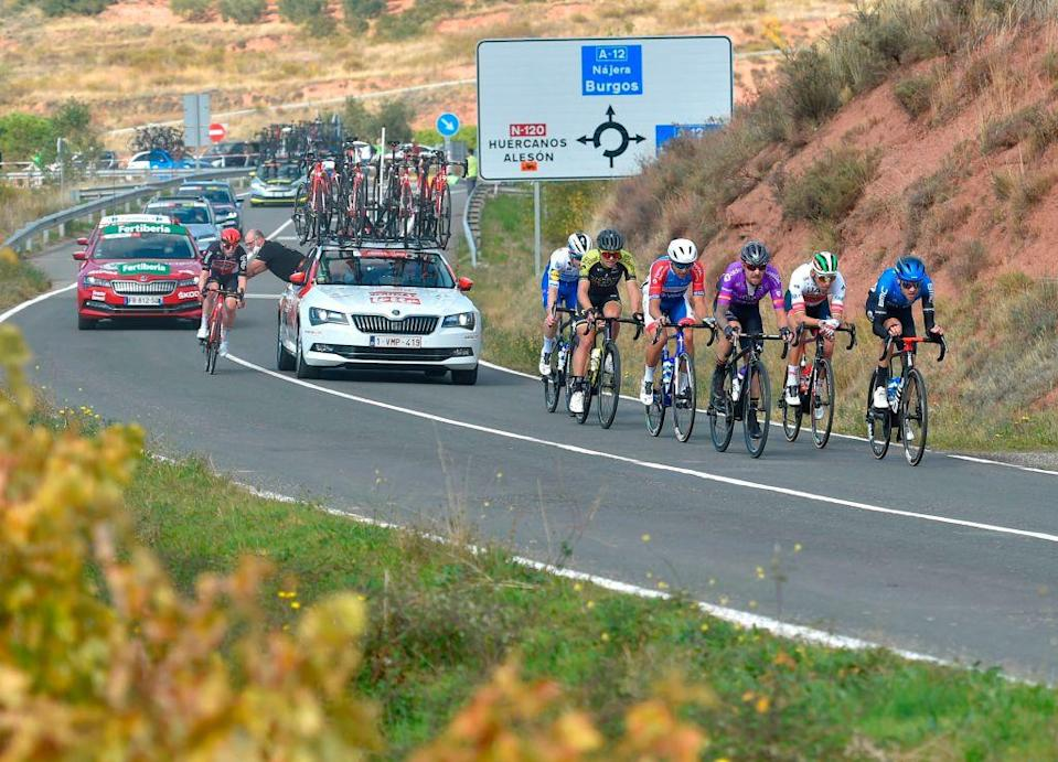 Cyclists ride in Ventosa during the 8th stage of the 2020 La Vuelta cycling tour of Spain a 164 km race from Logrono to Alto de Moncalvillo on October 28 2020 Photo by ANDER GILLENEA  AFP Photo by ANDER GILLENEAAFP via Getty Images