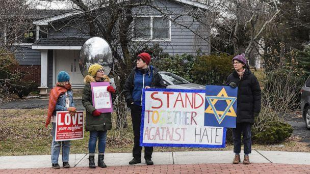 PHOTO: People hold signs of support near the house of Rabbi Chaim Rottenberg on Dec. 29, 2019, in Monsey, N.Y. Five people were injured in a knife attack during a Hanukkah party and a suspect, identified as Grafton E. Thomas, was later arrested in Harlem. (Stephanie Keith/Getty Images)