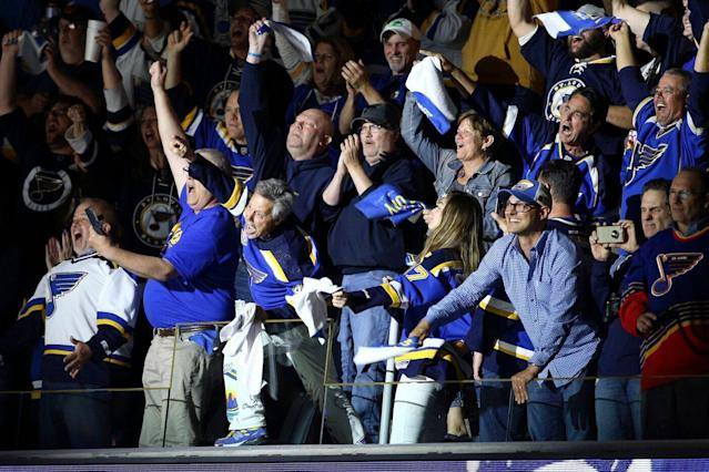 One frustrated St. Louis Blues fan tossed a beer onto the ice during the team's Game 6 loss to the Boston Bruins on Sunday. (AP Photo/Scott Kane)