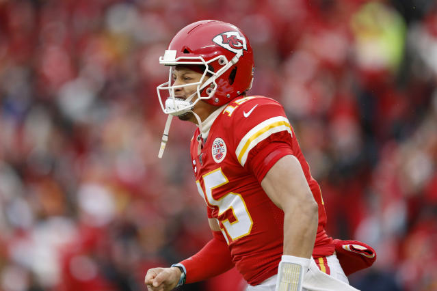 Kansas City Chiefs quarterback Patrick Mahomes (15) reacts after a Chiefs' touchdown during the first half of an NFL divisional playoff football game against the Houston Texans, in Kansas City, Mo., Sunday, Jan. 12, 2020. (AP Photo/Jeff Roberson)