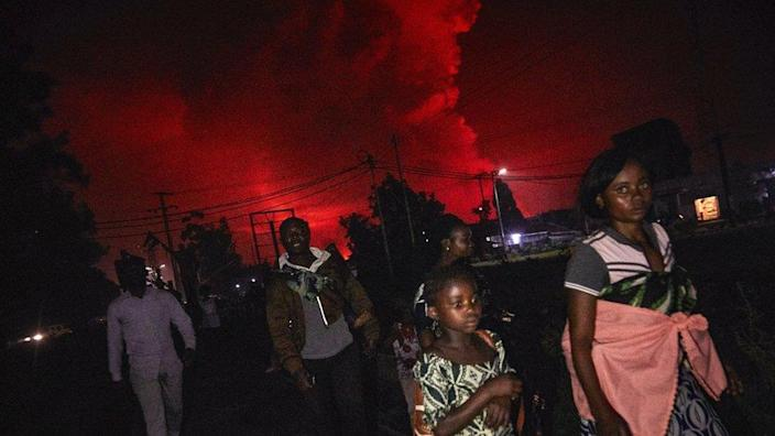 Congolese residents of Goma flee from Mount Nyiragongo volcano as it erupts over Goma