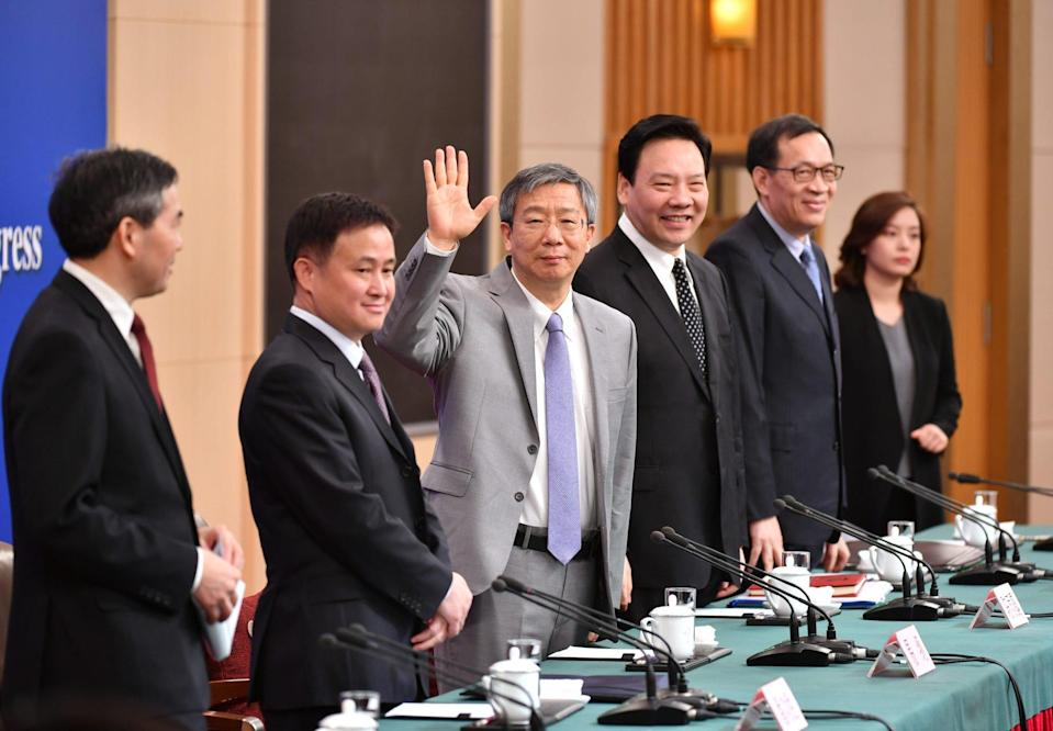 PBOC Yi Gang (3rd Left), PBOC deputy governor Chen Yulu (3rd Right), PBOC deputy governor and head of the State Administration of Foreign Exchange Pan Gongsheng (2nd Left) and PBOC deputy governor Fan Yifei (2nd Right) at a press conference on the financial reform and development in Beijing. Photo: Xinhua